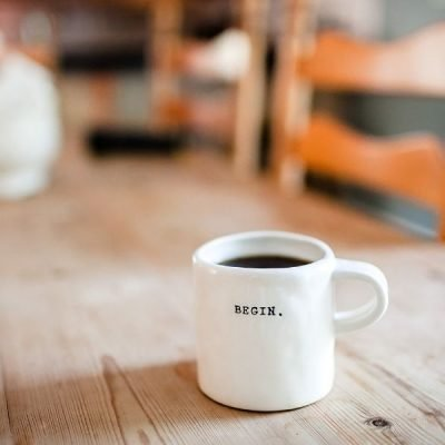 Image of a mug of coffee sitting on a table