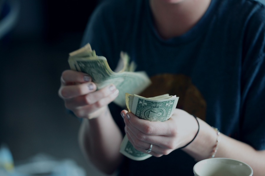 Photo of a woman counting money