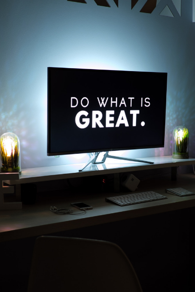 Picture of a desktop computer with the words 'do something great' on the monitor