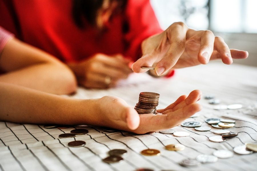 Image of a woman and child counting coins