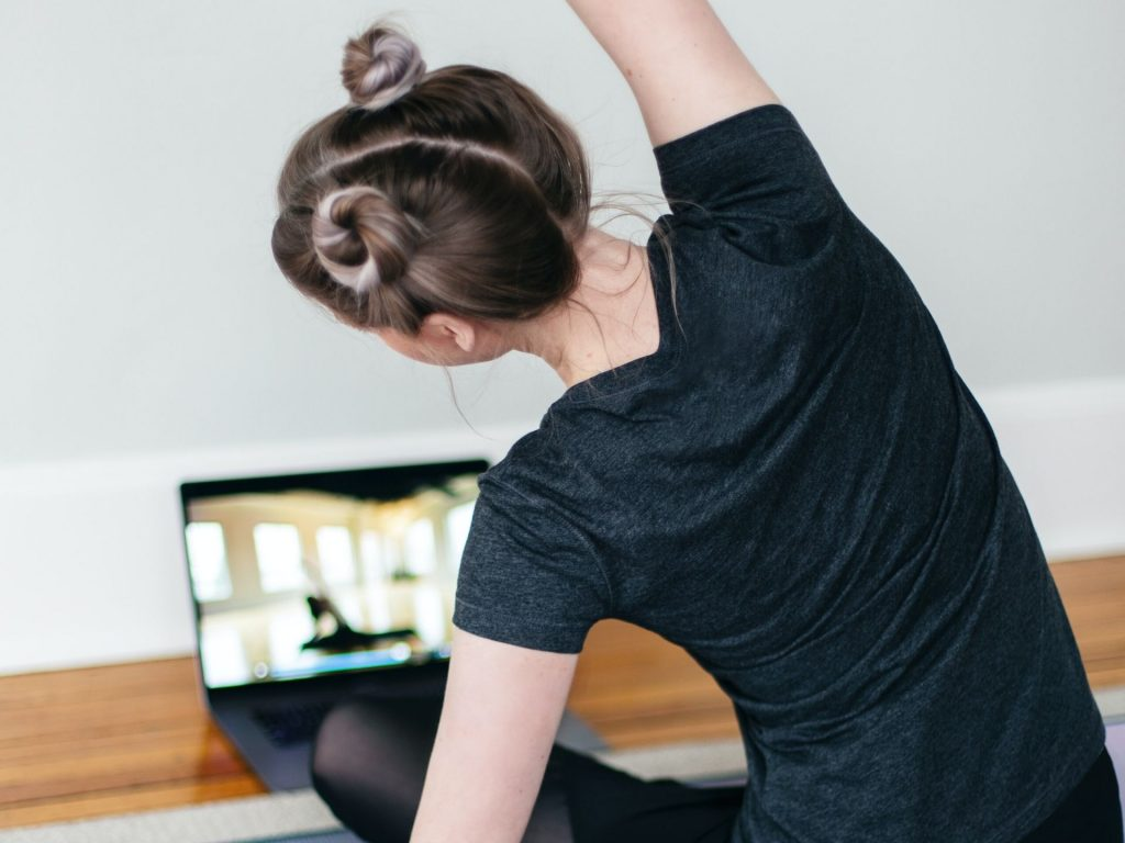 Image of a woman doing a Yoga video