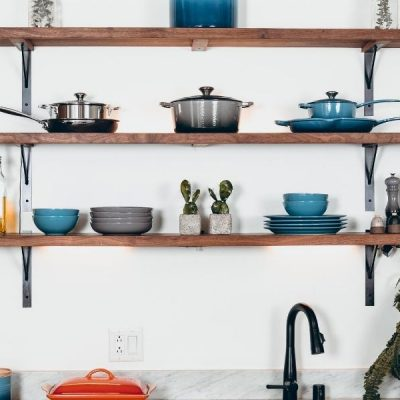 Image of expensive cookware on open wall shelving